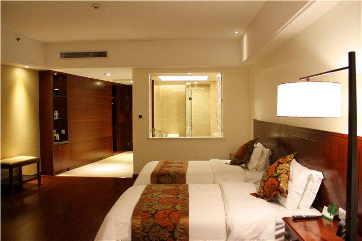 三亚湾新疆大厦度假酒店-豪华庭景双床房(畅游海南)