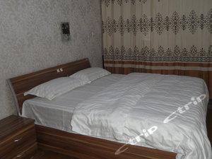我愛我家連鎖酒店式公寓(呂梁新汽車站店)