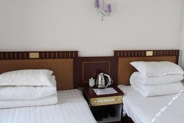 共和县扎西牧场酒店(一楼床位房1床位)