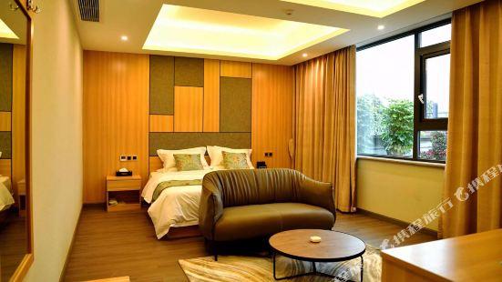 Xinjin Jinerxin Business Hotel