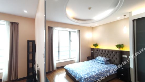 Xinshikong Xiaobai Apartment Hotel