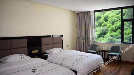 Huanglong Xinyi Xiuxian Hotel