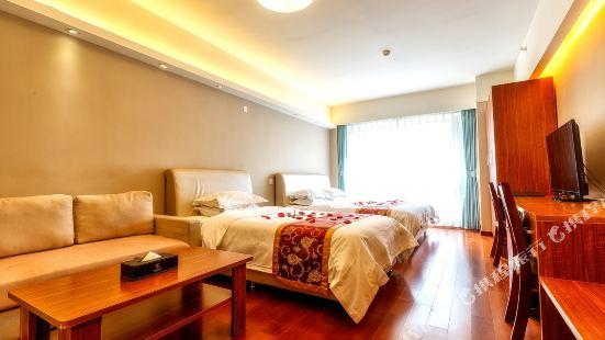Shenlan Holiday Apartment (Qingdao Thumb Plaza)