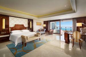 三亚唐拉雅秀酒店(海洋全景房+送机+小鱼温泉)