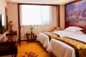 维也纳国际酒店标准房+家庭迪士尼平日门票